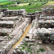 In the Biblical passage found in 1 Kings9:15 itnotes thatKing Solomonconstructed the city wall for the town of Gezer. Archaeologists working at the site have now identifiedSolomon's wall, and the photo displayed here shows the remains of the gated portion.