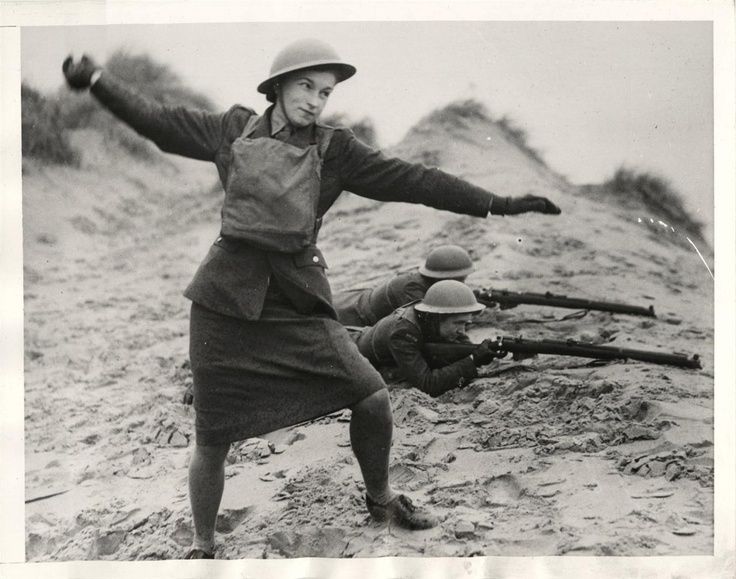"1944- Group of Polish women commandos, nicknamed ""Pestkis"", shown training with rifles and hand grenades in Scotland."