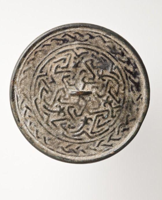 Mirror Afghanistan, 12th-13th century Bronze Diameter: 2 1/4 in. (6.4 cm)
