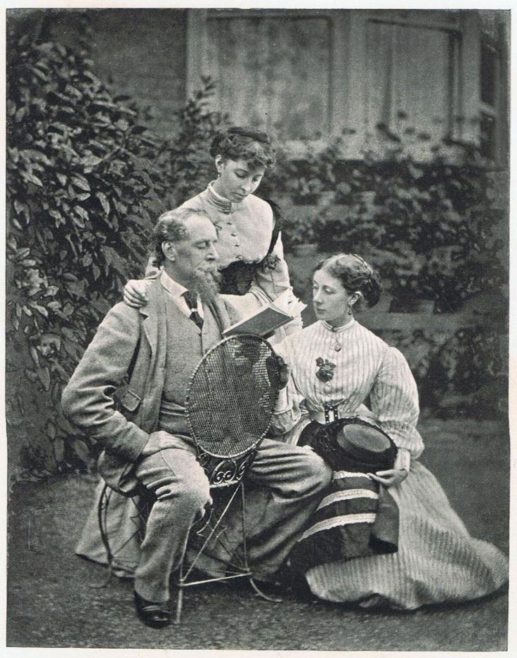 Charles Dickens reads to his daughters Mamie and Kate in the garden at Gad's Hill, Kent. 1865