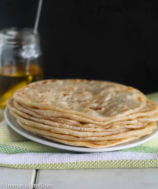 East African Chapatis- flaky , layered and Delicious. Quite different from Indian Chapati. Step-by-step pictorial.