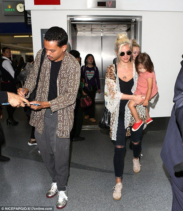 Back in LA! Ashlee Simpson Ross-Næss carried daughter Jagger as she and second husband Evan Ross Næss landed at LAX Airport on Friday after their vacation in her native Texas