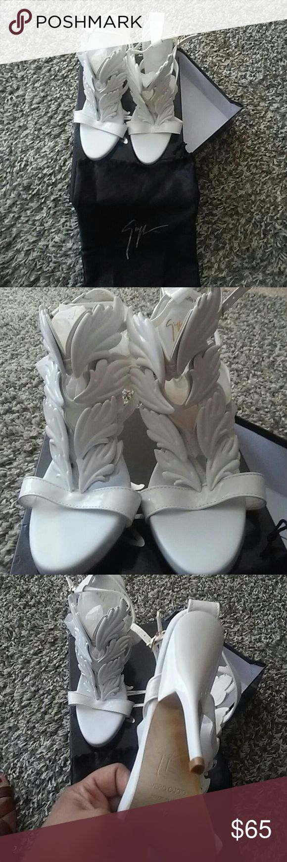 Giuseppe all white heels???? All white.. New worn.. They were gift...they run small so this is really will for person who wear a size 9 1/2 or 10 Giuseppe Shoes