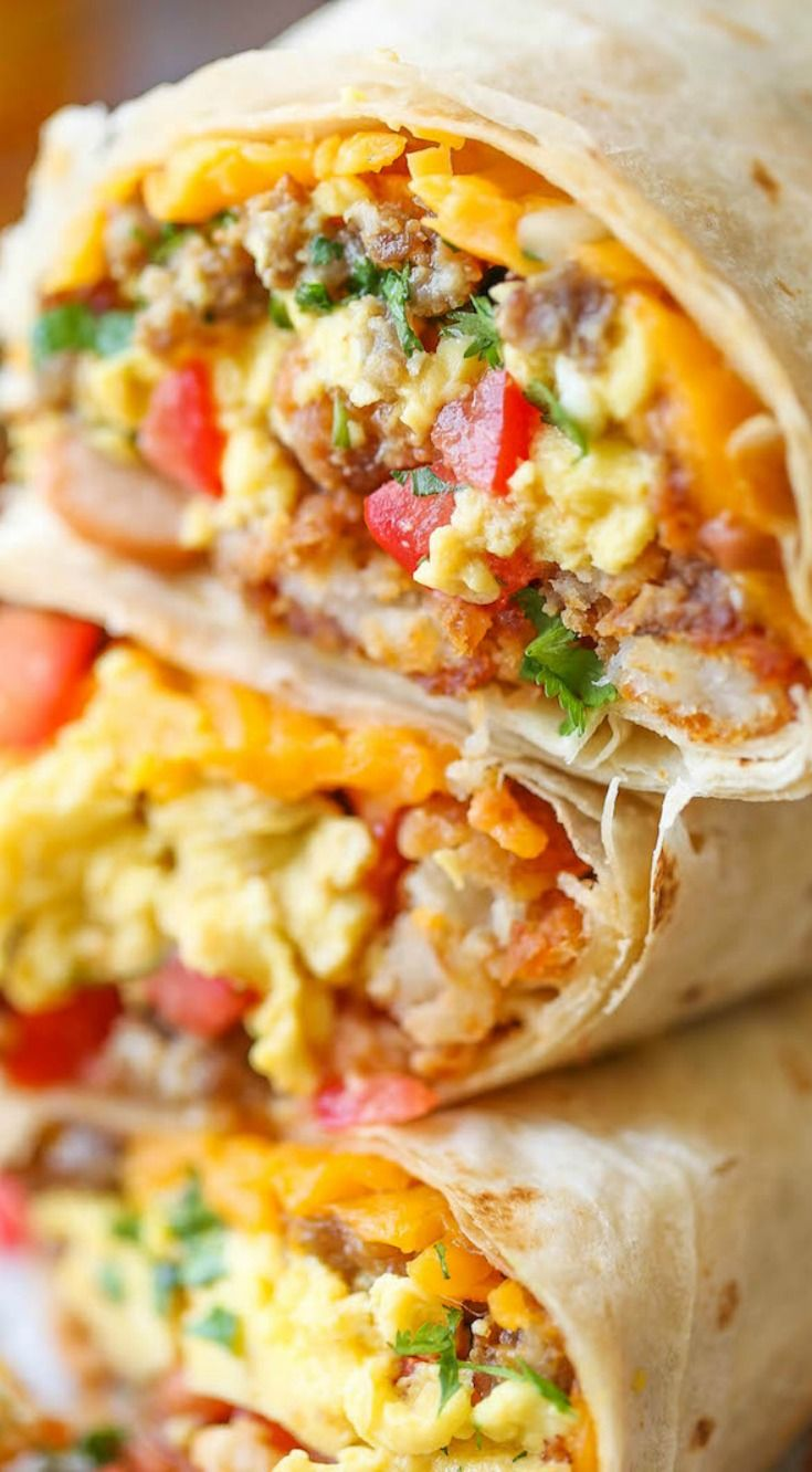 Freezer Breakfast Burrito ~ Loaded with tater tots, eggs, beans and cheese, of course... Meal prep over the weekend for the best burritos during the week.