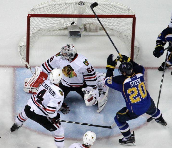 Alexander Steen scores the game-winning goal past Chicago Blackhawks goalie Corey Crawford and Niklas Hjalmarsson during the third overtime in Game 1 of a first-round NHL hockey Stanley Cup playoff series. 4-17-14