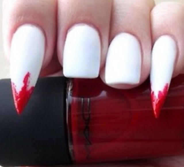 Would never personally do this, but the idea is cool. Vampire teeth nails. Halloween/ Stiletto nails / squared nails