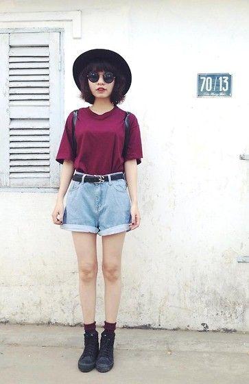 denim shorts + black hat
