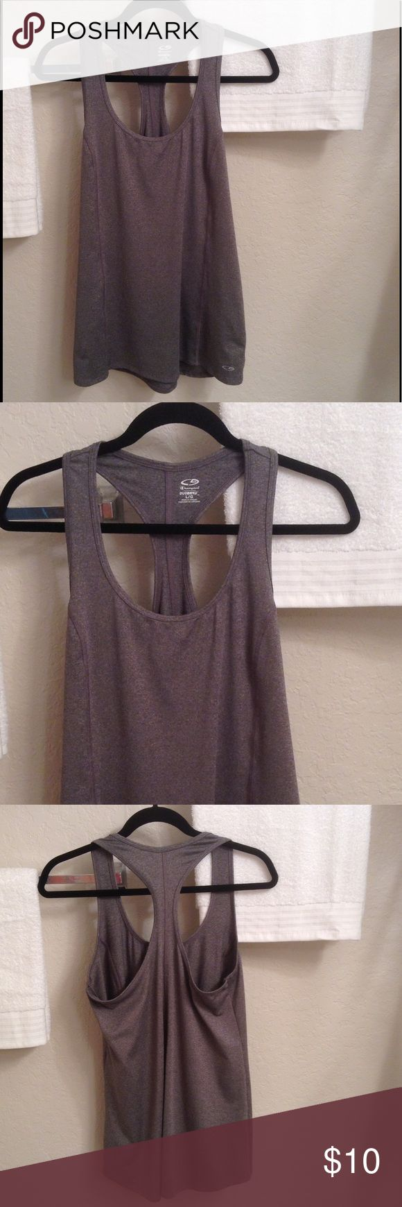 Champion Duo Dry Sleeveless Tunic This grey tunic with white specs throughout has a racerback & is 90% Polyester/10% Spandex.  The chest measures 36 inches, the length is 27 inches.  Perfect condition!! Champion Tops