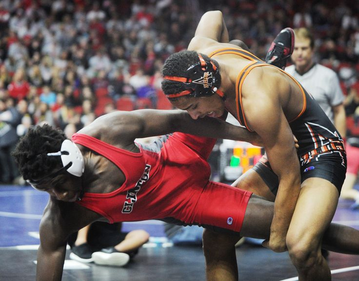 Ames' Marcus Coleman takes down Clinton's Trajae Lackland during their 170-pound match at the Class 3A state meet at Wells Fargo Arena in Des Moines on Thursday. Photo by Nirmalendu Majumdar/Ames Tribune  http://amestrib.com/sports/state-wrestling-ames-coleman-townsend-win-first-round-state-matches