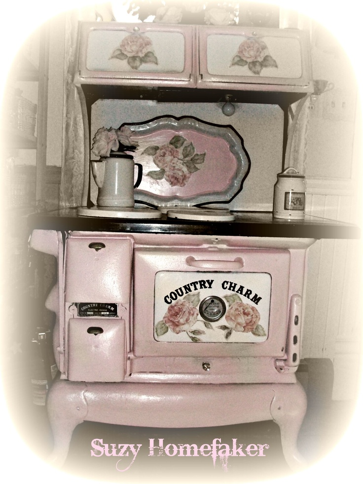 Pink Antique Stove. I love Suzy's site and had asked her how she did this?  She got the paint from an auto body shop, and had them put the paint in small spray paint cans. The paint used is heat resistant. She also used Decoupage. I love this. TY Suzy.