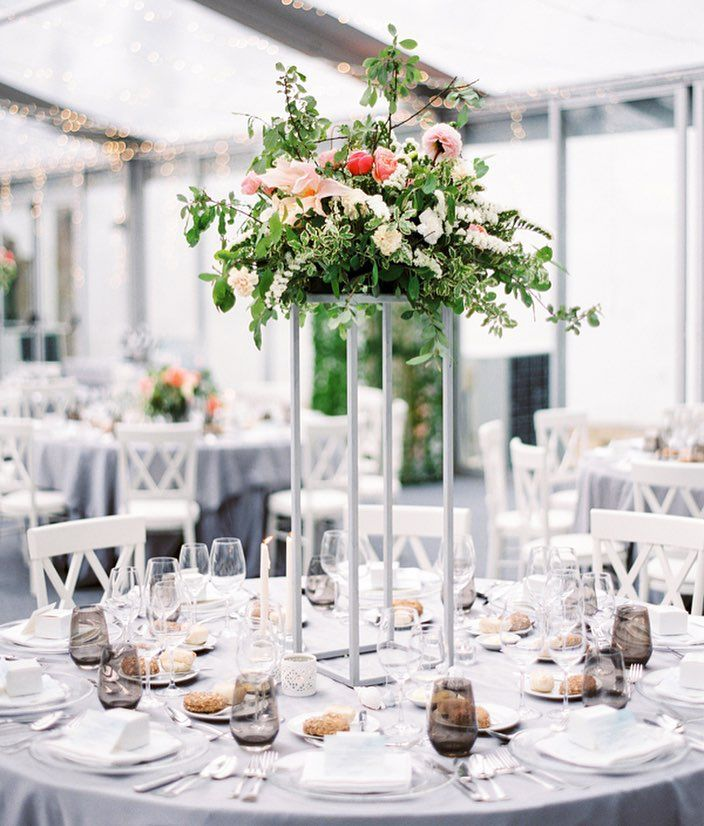 It's always a good idea to add depth and dimension when designing a space. In this particular wedding we mixed tall and low centerpieces, a perfect combination that matches the overall vision for this event.  #MarthaWeddings