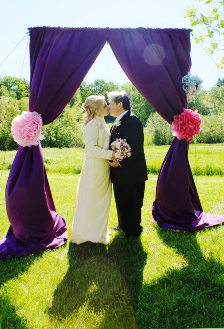 A kiss in the fall sun. Wedding backdrop by www.photo42.ca .Packages from $1000. Bride and groom. Mississauga Park.