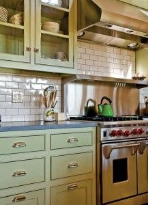 an eco friendly farmhouse green cabinets stove and