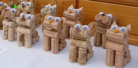 dog and cat figurines made from recycled corks.