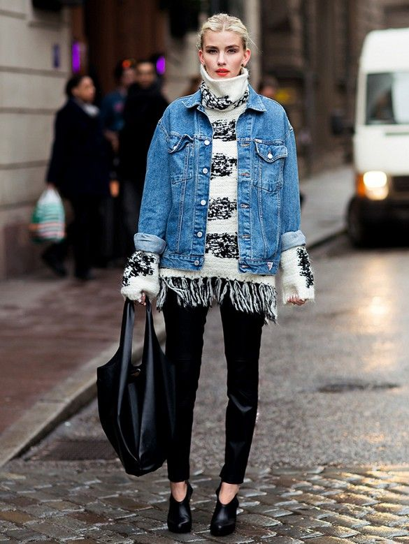 Fringed turtleneck sweater layered underneath a denim jacket, and worn with black pants for a stylish but casual look