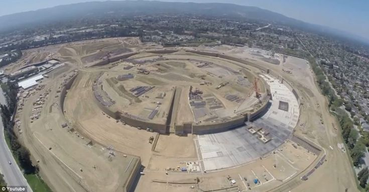 Drone snoops on Apple's 'spaceship' campus: Aerial footage reveals progress on the futuristic 175 acre building site  Read more: http://www.dailymail.co.uk/sciencetech/article-2739618/Drone-snoops-Apples-spaceship-campus-Aerial-footage-reveals-progress-futuristic-175-acre-building-site.html#ixzz3C5btwrTI  Follow us: @MailOnline on Twitter | DailyMail on Facebook
