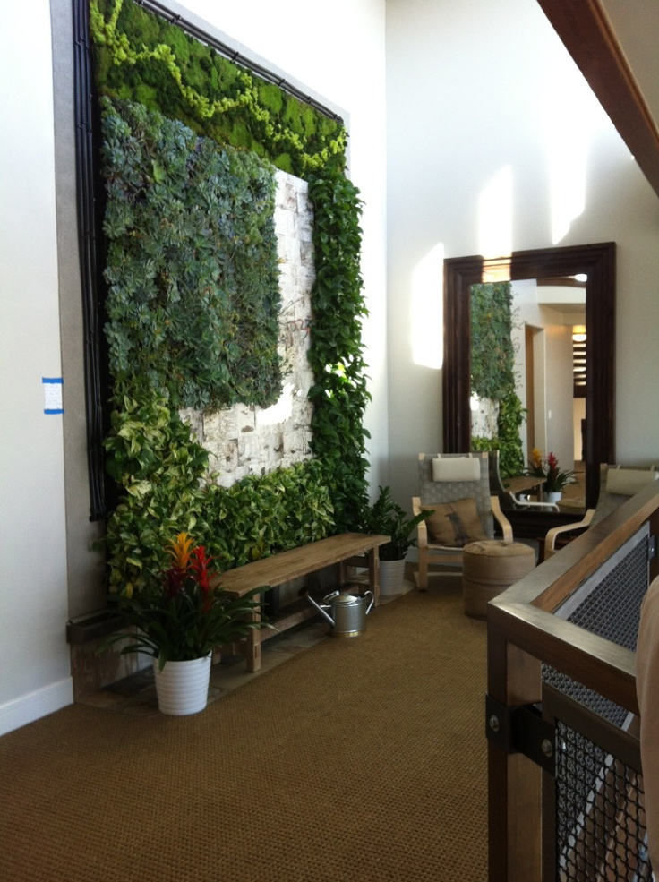 living wall - those are real, live plants growing on this indoor balcony  wall!