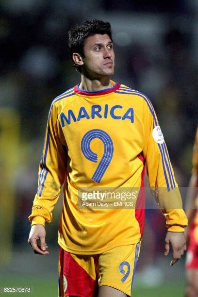 Romania's Ciprian Marica celebrates after the final whistle