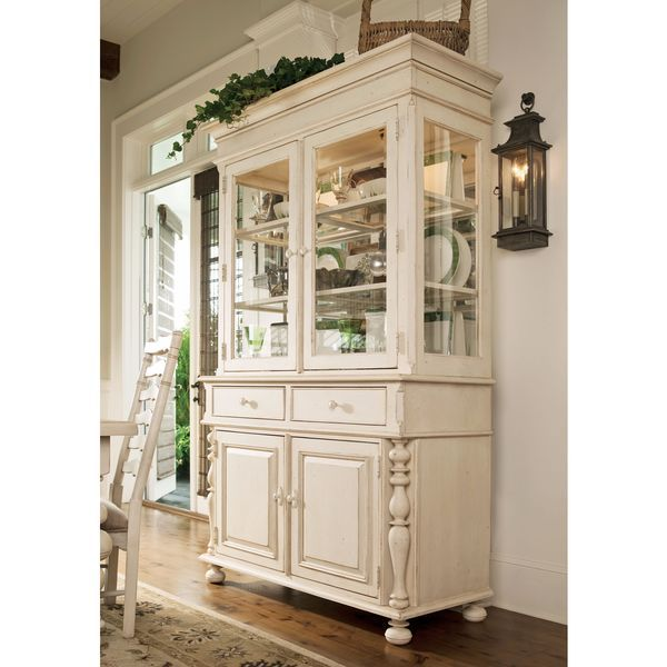 Finish off your desired contemporary look with this Paula Deen Home Linen China Buffet Hutch. Made of cherry wood and veneers, this piece features a stunning linen finish that will complement the othe