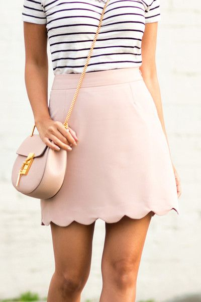 Elevate your office-to-evening repertoire with this scalloped skirt. Rendered in a swoon worthy blush and finished with a sweetly scalloped hem, this feminine update on a closet staple delivers an uptown style statement perfect for any occasion. Fits true to size, order your normal size Designed for a classic fit Flat front, scalloped hem, pencil-skirt silhouette Concealed back zip with hook-and-eye closure, back vent, lined