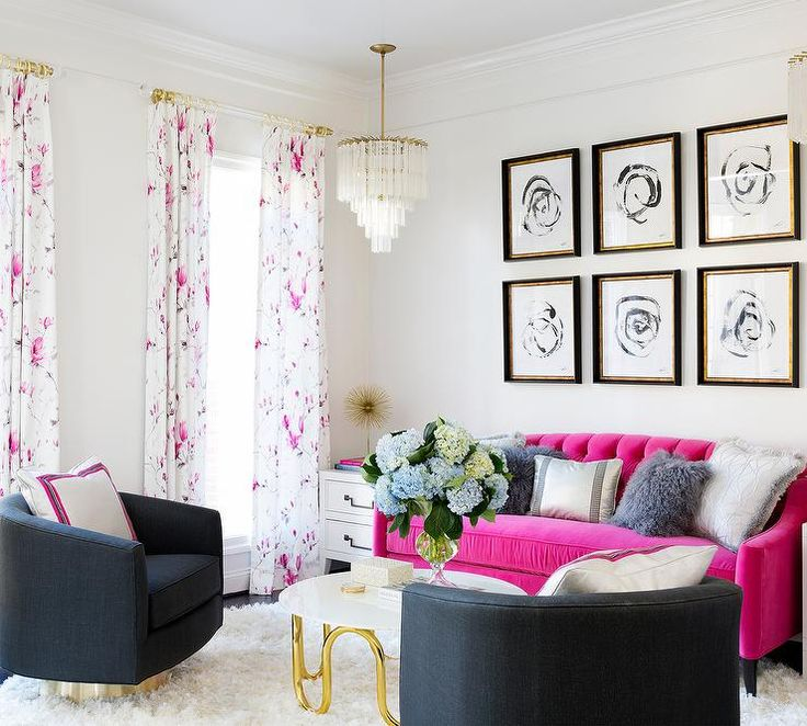 Girly Contemporary Living Room Boasts Two Rows Of Black And White Abstract Art In Gold