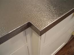 Hammered stainless steel countertop.                                                                                                                                                                                 More
