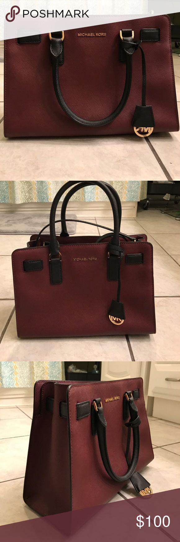 Merlot/Black Selma Michael Kors Purse Merlot & black Michael Kors purse, gently used, no scrapes, no stains inside or creased leather. Michael Kors Bags Satchels
