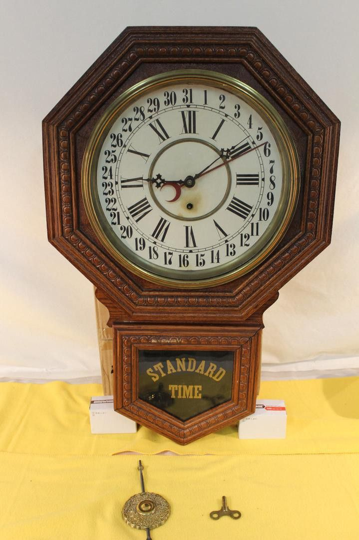 ANTIQUE OAK GILBERT ADMIRAL REGULATOR WALL CALENDAR CLOCK  STANDARD TIME This lot brings a beautiful Gilbert Regulator Wall Calendar Clock. This Admiral Clock has been preserved well for it's age. It