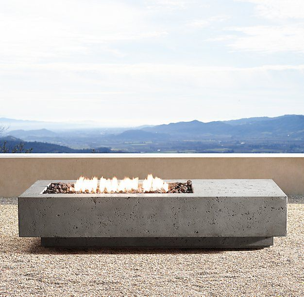 "RH Modern's 72"" Ixtapa Propane Asymmetrical Rectangle Fire Table:Set the stage for outdoor ambience with the warmth of a clean-burning hearth. Our handcrafted fire table, made from glass fiber reinforced concrete, is finished with a multi-step process that captures the look and luxurious feel of natural limestone. Heat resistant to the touch, it uses eco-friendly clean-burning fuel."