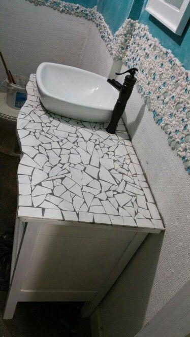 Leftover tile on top of a used wood dresser transformed
