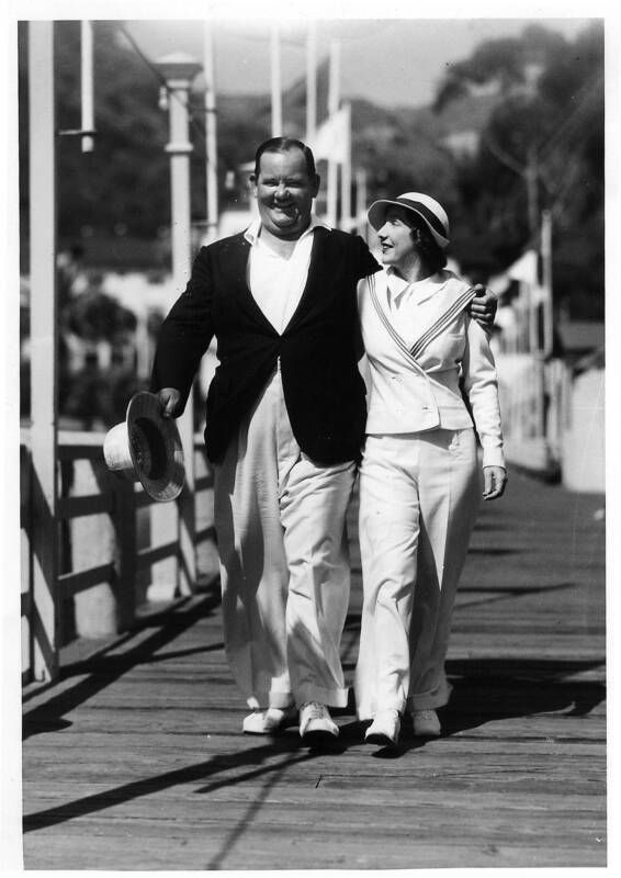 Mr. and Mrs. Oliver Hardy enjoy a nice stroll down Avalon, Catalina Pier.