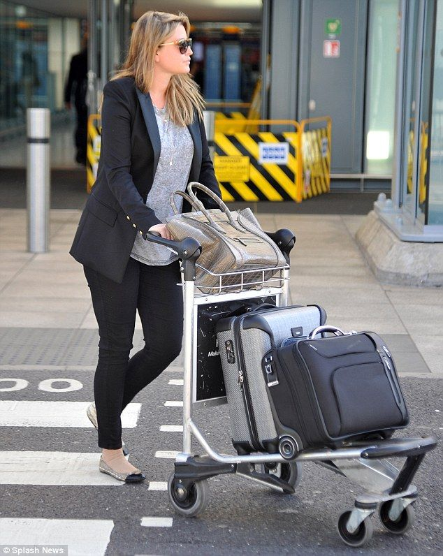Holly Valance and husband Nick Candy land at Heathrow Airport from Los Angeles