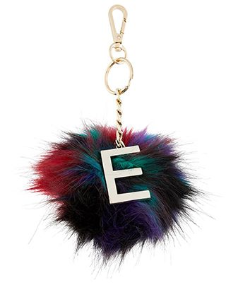 Add a statement touch to your most-loved handbag with our initial pom pom bag charm. This multi-coloured faux fur design is adorned with a glossy gold-tone m...
