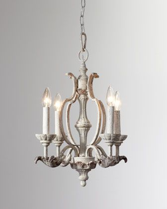 Mini chandelier with antique styling features classic bobeches wrapped in intricate leaf designs. Made of steel and resin. Hand-painted Persian-white finish. Uses four 60-watt bulbs. Direct wire; prof