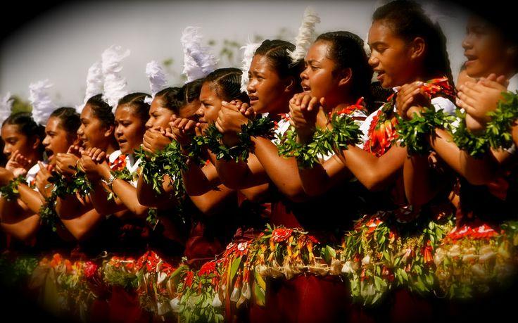 Tonga History and Culture | Tongan girls performing a lakalaka in Tonga.