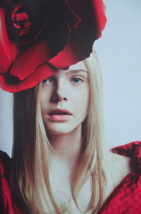 elle fanning by damon heath. I wish I could wear a giant flower on my head and get away with it