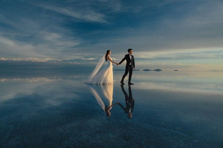 the couple in this engagement shoot looks like they are standing on an endless mirrored sea | Image by Ekaterina Mukhina Photography