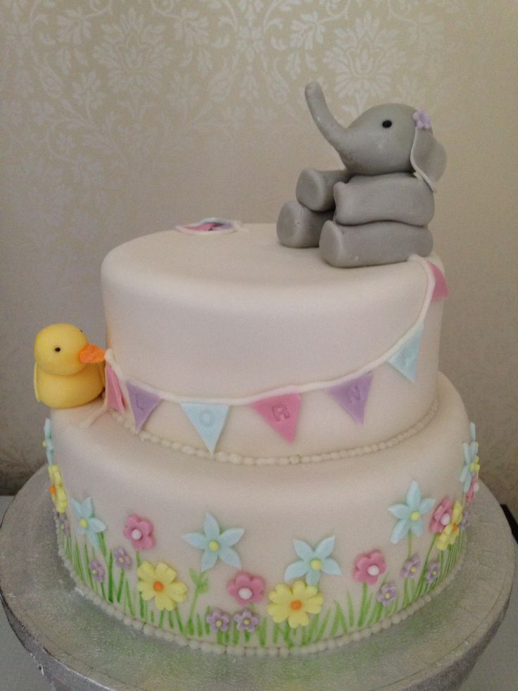 Lorna's christening cake with elephant duck flowers and bunting