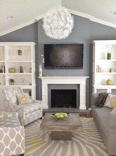 Love this Grey living room but would replace the carpet with a white/ cream shag rug, this would make the room seem more homey and warm.