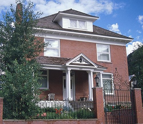 Simple Foursquare houses were built in brick, stone, stucco, concrete block, or wood.