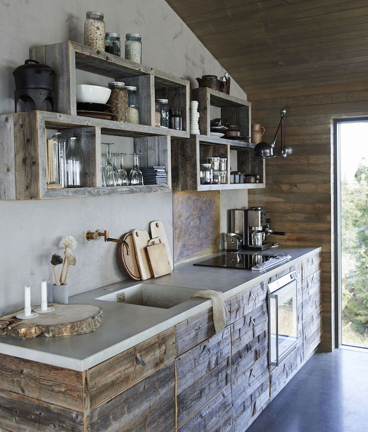 A kitchen made from reclaimed barn wood in a magical Norwegian mountain cabin from the book The Scandinavian Home by Niki Brantmark.