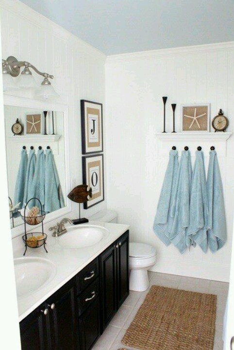 Love the crisp black & white bathroom - and I like the touches of blue & tan  I have the stuff to make this work