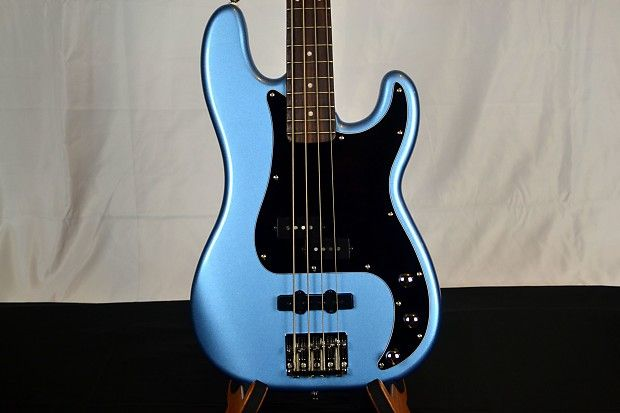 Get the best of both worlds with the Squier®Vintage Modified Precision Bass®PJ solidbody electric bass guitar. With a dose of both Precision and Jazz Bass®pickups, the Vintage Modified Precision Bass PJ delivers fat, full-bodied tone with a shot of defined growl. The resonant agathis body is contoured for comfort and playability. A C-shaped maple neck, topped with rosewood, lets you craft tasty bass grooves with ease. If you want the quality of FENDER®at an affordable price, pick up a…