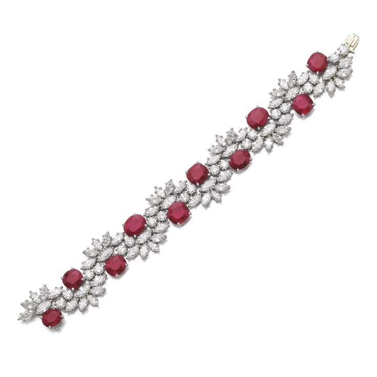 RUBY AND DIAMOND BRACELETSet with oval and cushion-shaped rubies, highlighted with marquise-shaped and brilliant-cut diamonds, length approximately 175mm, maker's mark for Jacques Timey. ||| sotheby's