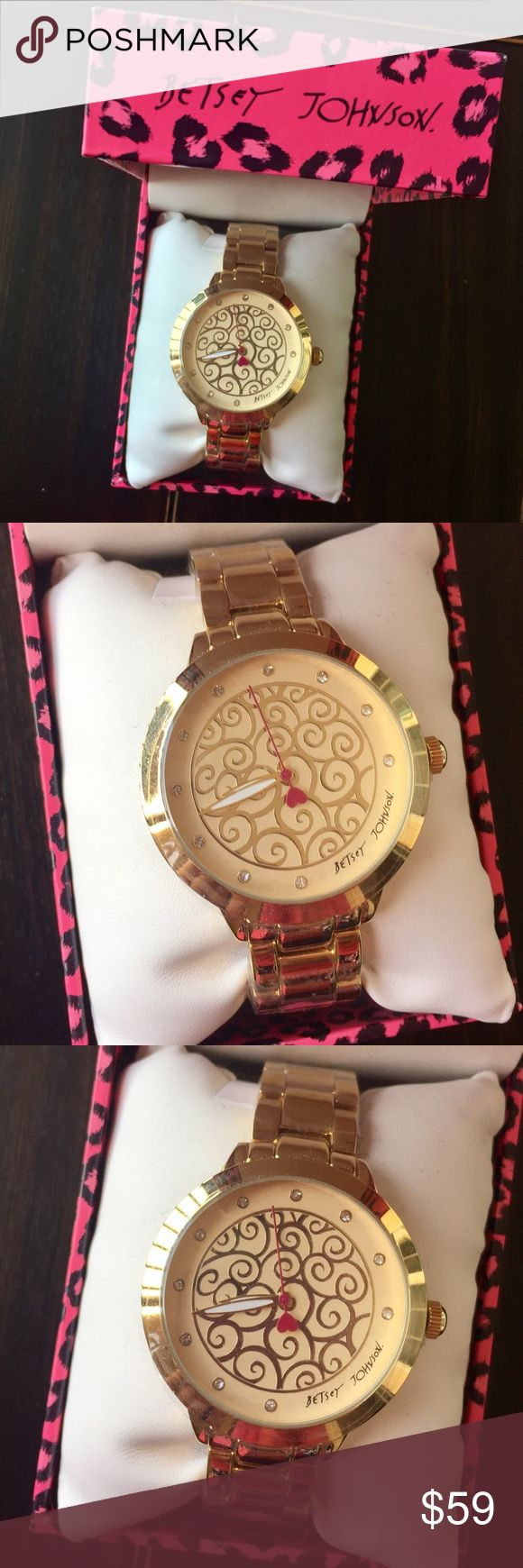 Betsey Johnson Gold Mosaic Watch New in Box Betsey Johnson Gold Mosaic Watch  - comes in original pink leopard print Betsey box.                             - Dial Color: Gold with unique mosaic design  - Hands: White luminous and fuchsia second hand - Markers: Crystal Stone - Bracelet material: Stainless steel - Movement: Quartz Betsey Johnson Accessories Watches