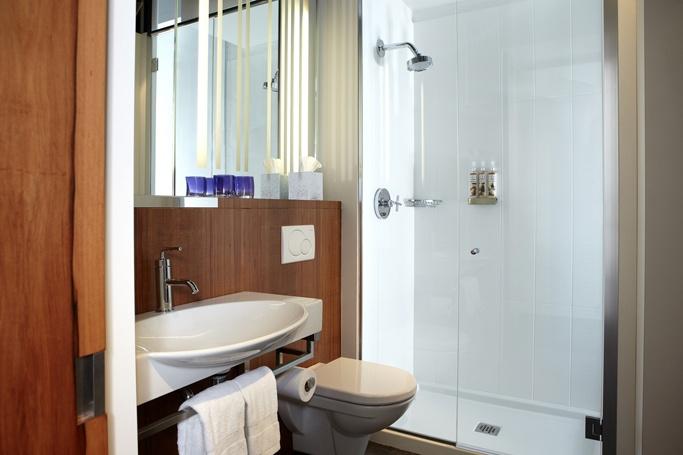 LEMAYMICHAUD | ALT | Toronto | Pearson Airport | Architecture | Design | Hospitality | Hotel | Room | Suite | Bathroom | Powder Room | Shower |