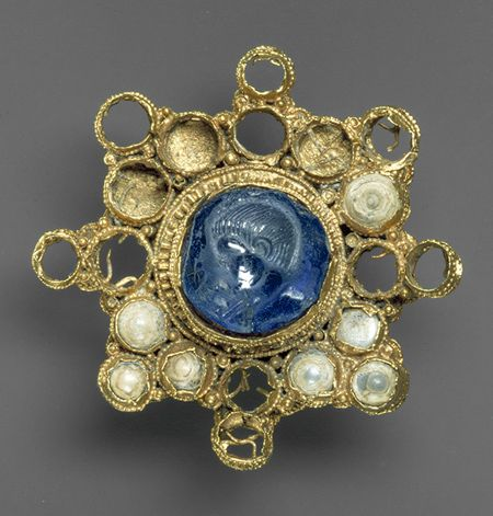 Ottonian - Byzantine Star-Shaped Sapphire and Pearl Brooch with Intaglio. Byzantine intaglio dates from c. 337 - 361, Ottonian setting c. 960 - 1000