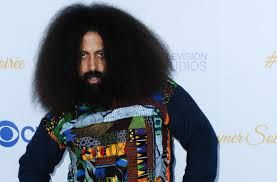 reggie watts wearing a Blazinbell sweater