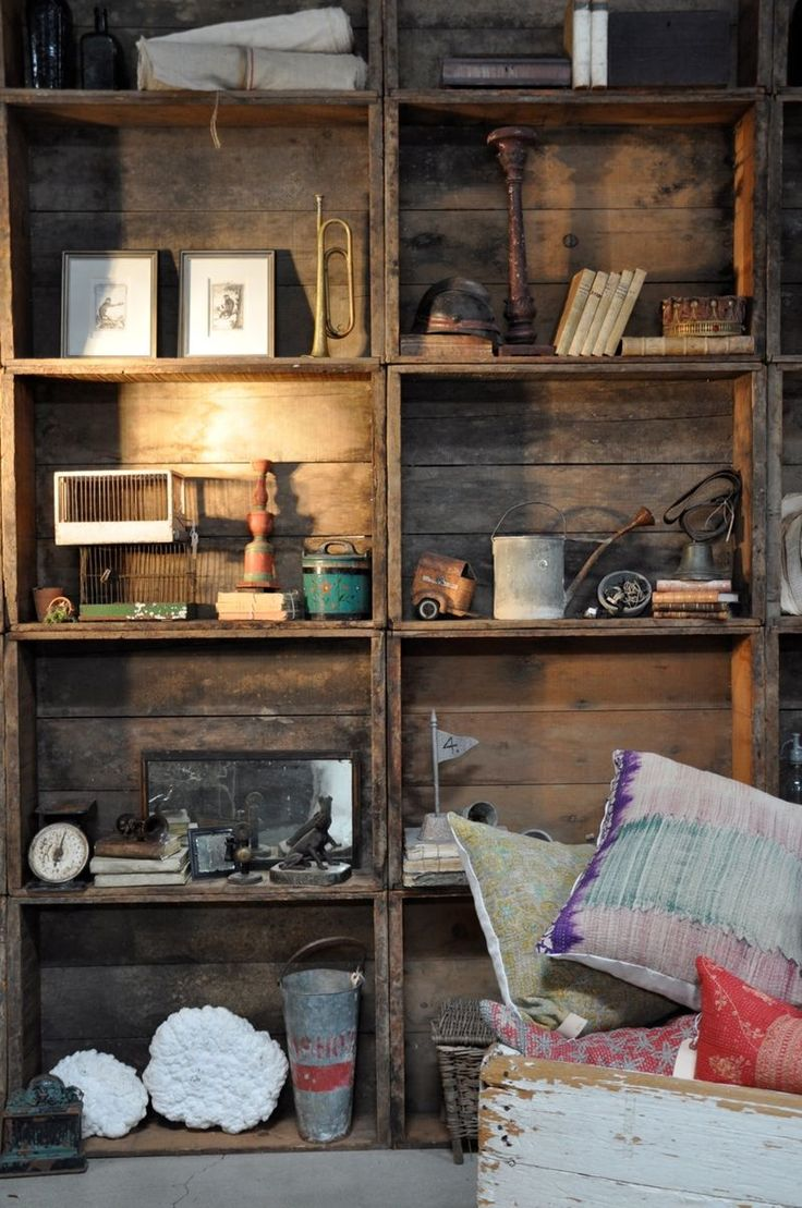 A wall of weathered wood cubbies