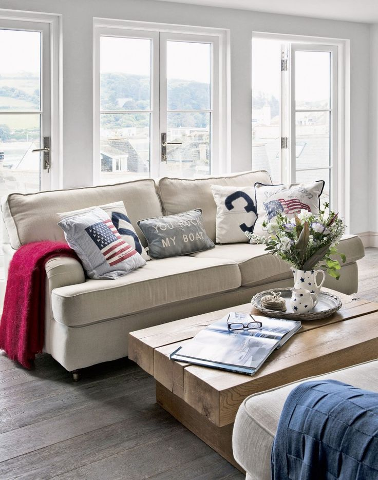 Create smart New England coastal style in your living room with comfortable linen sofas and a low chunky oak beam coffee table